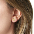 Mismatched Heart Stud Earrings in Gold on Model