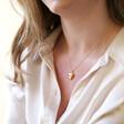 Model Wearing Lisa Angel Birthstone Heart Locket Necklace in Gold