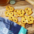 Pretzel things spilling out of Olly's Original Salted Pretzel Thins Bag from Lisa Angel
