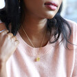 Personalised Engraved Gold Birth Flower Organic Shape Necklace as Worn on Model