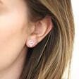 Sterling Silver Family Tree Heart Stud Earrings on Model