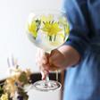 model holds stem of lisa angel daffodil balloon gin glass standing