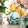 Glass mister and Ceramic Turquoise Swimsuit Planter from Lisa Angel