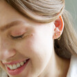 Lisa Angel Ladies' Crystal Star Stud Chain Earrings in Gold on Model