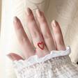 Model Wearing Gold Sterling Silver Red Enamel Heart Outline Ring