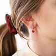 Model Wears Red Enamel Heart Charm Huggie Hoop Earrings