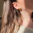 Model Wearing Lisa Angel Ladies' Mismatched Fish and Shell Earrings in Gold