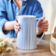 Lisa Angel Blue and White Striped Jug held by model