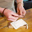 Packaging for Lisa Angel Men's Personalised Slim Woven Leather Bracelet in Vintage Match Box
