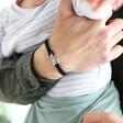 Lisa Angel Engraved Men's Woven Black Cord and Stainless Steel Bead Bracelet on Model