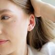 Model Wearing Lisa Angel Gold Sterling Silver Crystal Huggie Hoop Earrings