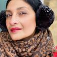 Model Wearing Lisa Angel Personalised Embroidered Year Animal Print Blanket Scarf in Camel
