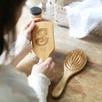 Lisa Angel Personalised Initial Bamboo Hairbrush Held by Model