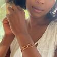 Lisa Angel Ladies' Infinity Link Torque Bangle in Rose Gold on Model