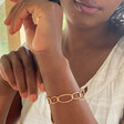 Model Wearing  Lisa Angel Ladies' Infinity Link Torque Bangle in Rose Gold