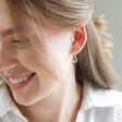 Lisa Angel Crystal Moon Huggie Hoop Earrings in Gold on Model