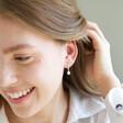 Model Wears Lisa Angel Glass Pearl Huggie Hoop Earrings in Silver