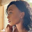 Model Wears Lisa Angel Ladies' Large Thin Heart Hoop Earrings in Sterling Silver