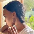 Lisa Angel Ladies' Large Thin Heart Hoop Earrings in Sterling Silver on Model