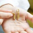 Lisa Angel Wing Charm Huggie Hoop Earrings in Gold with Model