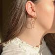 Model Wearing Ladies' Sleeping Crescent Moon Face Drop Earrings in Gold