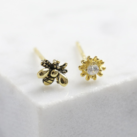Tiny Daisy and Bee Studs in gold plated 925 sterling silver.