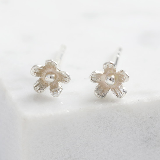 Tiny daisy studs in 925 sterling silver.