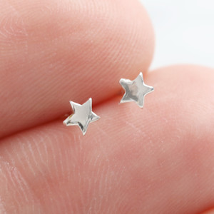 Tiny Star studs in 925 silver.