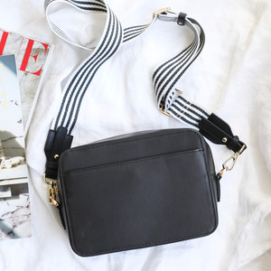 Zip Top Black Leather Bag with Open Front Pocket with webbing strap in black and white 5cm wide