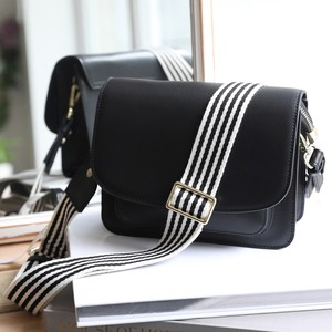 Flapover Black Leather Bag with Striped Webbing Strap  in black and white 5cm wide
