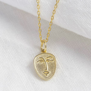 Small Sterling Silver face pendant necklace in gold plated 925.