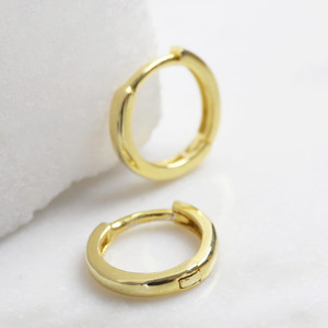 Small hoop sterling huggie earrings with gold plate.