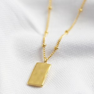 Tiny Hammered Tag Pendant Necklace in Gold