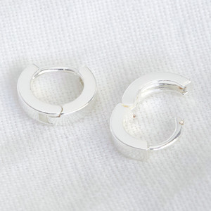Sterling Silver Tiny Huggies ( 8mm at widest point)
