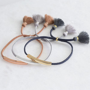 Gold beaded bar bracelet 4mm tube (wider) with navy suede and tassel