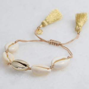 Shell Bracelet with Gold Central Shell and Tassel Back in Gold