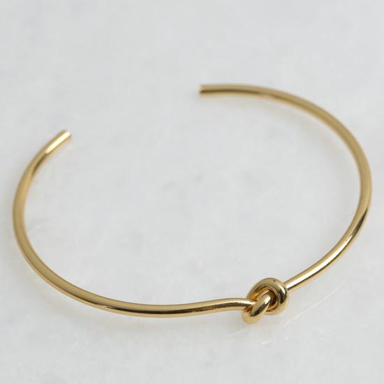 Shiny  gold plated brass thin knot bangle