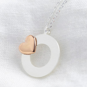 Silver disc and rose gold heart necklace