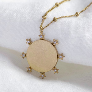 Crystal Star Edge Disc in Worn Gold Finish on Satellite Chain.