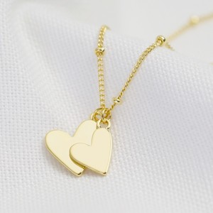 Falling Double Hearts on Satellite chain necklace in gold plate