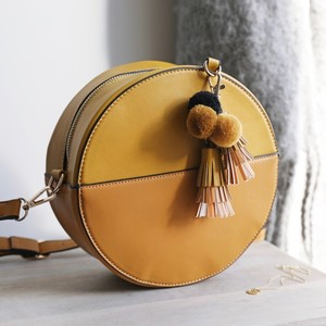 Round Mustard Shoulder Bag with Pompom Tassels