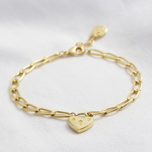 Gold Figaro chain bracelet with heart lock