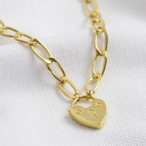 Gold Figaro chain necklace with heart lock