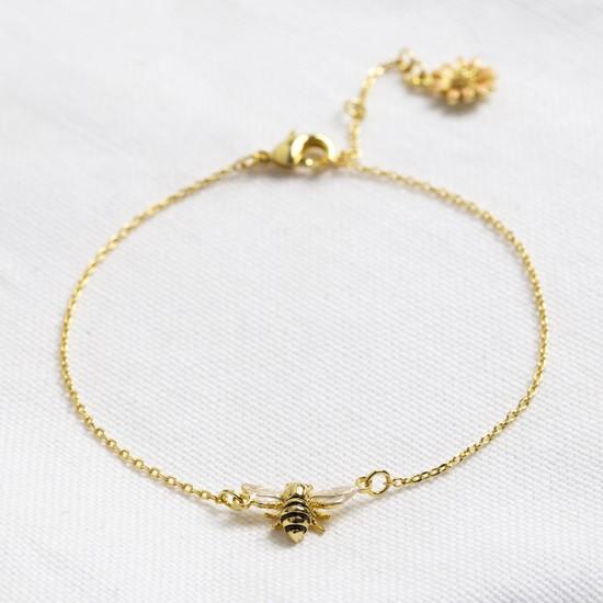 Enamel bee bracelet with peach daisy