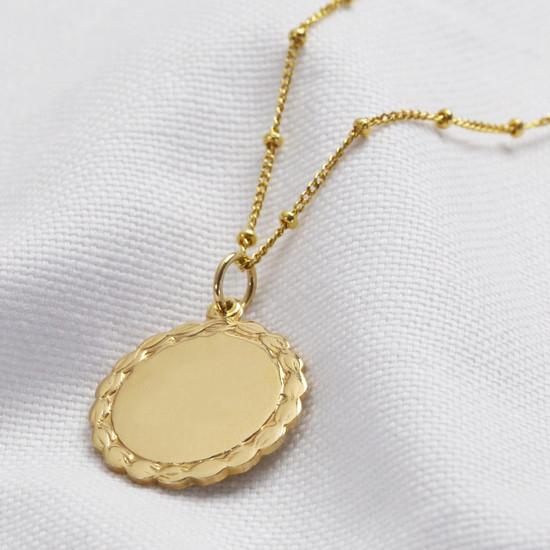 Plain laurel leaf disc- gold plated sterling silver
